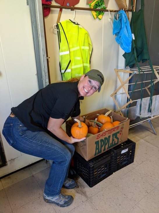 Ruth receiving a pumpkin delivery at the HES kitchen.